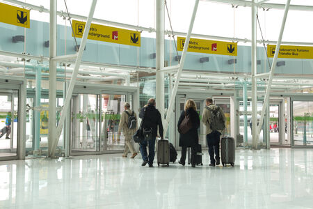 tonnes: LISBON, PORTUGAL - MAY 29, 2014: Airline passengers exiting the main entrance of the Lisbon airport. In 2013, the Lisbon airport handled 16,024,955 passengers and 88,459 tonnes of cargo. Editorial