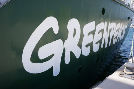 greenpeace: VALENCIA, SPAIN - JUNE 9, 2014: The side of Greenpeaces vessel the Rainbow Warrior at the pier in Valencia. Greenpeace has offices in over 40 countries. Editorial