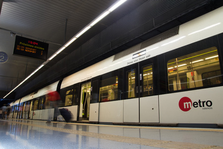 VALENCIA, SPAIN - JUNE 9, 2014: The Valencia Metro at the Rosa station. The  metro network consists of more than 134 kilometers (83 mi) of track, of which 19 kilometers (12 mi) is below ground.