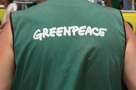 greenpeace: VALENCIA, SPAIN - JUNE 10, 2014: A crew member from Greenpeaces vessel the Rainbow Warrior at the Port of Valencia. Greenpeace is a nongovernmental environmental organization with offices in over 40 countries. Editorial