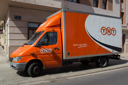 VALENCIA, SPAIN - JUNE 10, 2014:  A TNT Express truck in Valencia.  TNT Express is an international courier delivery services company with sales of over €6.69 billion in 2013.