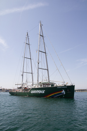 greenpeace: VALENCIA, SPAIN - JUNE 10, 2014: Greenpeaces vessel the Rainbow Warrior departing the Port of Valencia. Greenpeace is a nongovernmental environmental organization with offices in over 40 countries.