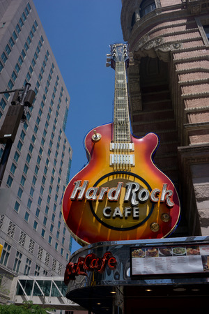 PHILADELPHIA - MAY 25, 2014: Hard Rock Cafe guitar signage at the Philadelphia, PA location. The Hard Rock Cafe has been collecting guitars since Eric Clapton donated his in 1979. Stock Photo - 29224308