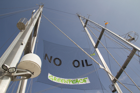 greenpeace: VALENCIA, SPAIN - JUNE 10, 2014: The mast of Greenpeaces vessel the Rainbow Warrior at the Port of Valencia. Greenpeace is an environmental organization with offices in over 40 countries.