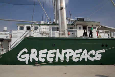 greenpeace: VALENCIA, SPAIN - JUNE 10, 2014: The side of Greenpeaces vessel the Rainbow Warrior at the pier in Valencia. Greenpeace is a nonprofit environmental organization with offices in over 40 countries. Editorial