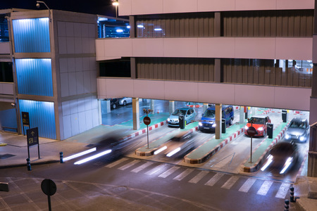 car park: VALENCIA, SPAIN - JUNE 25, 2014: Cars exiting the parking garage at the Valencia airport.  Situated 8 km from the city it is the 8th busiest Spanish airport with flight connections to 15 European countries. Editorial