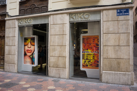 beauty shop: VALENCIA, SPAIN - AUGUST 7, 2014: A Kiko Milano cosmetics store in Valencia. Kiko Milano, founded in 1997, is a trendy, affordable cosmetics brand from Italy.