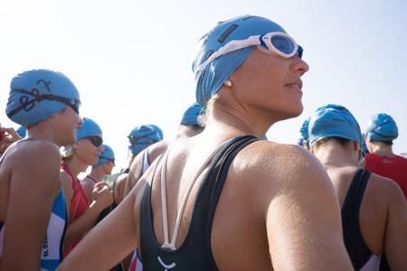 Valencia, Spain - September 6, 2014: A woman athlete preparing for the swim section of the Women's Toro Loco Valencia Triathlon.