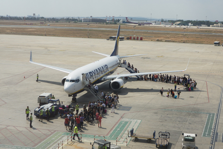 scheduled: Valencia, Spain. 10th September, 2014. Passengers boarding a Ryanair Boeing 737-800 aircraft at the Valencia airport.  In 2013, Ryanair was the largest European airline by scheduled passengers carried. Editorial