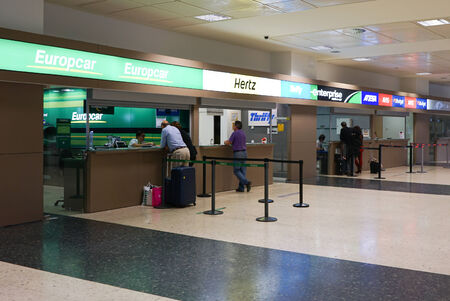 hertz: VALENCIA, SPAIN - SEPTEMBER 25, 2014:  Rental car counter at the Valencia Airport. Approximately 4.98 million passengers passed through the Valencia airport in 2013.