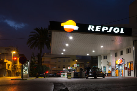 gas station: VALENCIA, SPAIN - SEPTEMBER 27, 2014: A Repsol gas station in early evening. Repsol is a Spanish multinational oil and gas company based in Madrid. It is the 15th largest fuel refining company in the world.