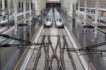 MADRID, SPAIN - OCTOBER 9, 2014: High speed trains in Atocha Station in Madrid. Spain's main cities are connected by high-speed trains. Editorial