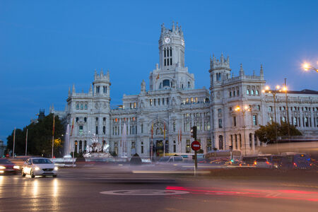 palacio de comunicaciones: MADRID, SPAIN - OCTOBER 10, 2014: The Madrid City Hall building at night.  Formally it was the Spanish Postal Service office until 2007 when it was converted into the City Hall offices.