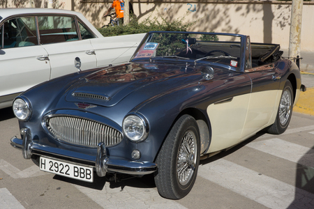 VALENCIA, SPAIN - OCTOBER 26, 2014: A blue and white 1962 Austin-Healey 3000 MK II Convertible at the Mansis Car show in Valencia, Spain.