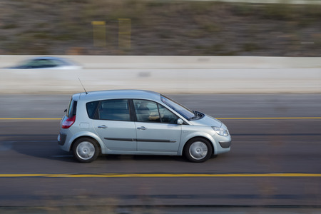 automaker: VALENCIA, SPAIN - NOVEMBER 7, 2014: A Renault Scenic auto on the highway in Valencia. The Scenic is a compact mult-purpose vehicle (MPV) produced by French automaker Renault. Editorial