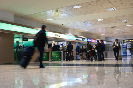 thrifty: VALENCIA, SPAIN - NOVEMBER 26, 2014: Rental car counter at the Valencia Airport. Approximately 4.98 million passengers passed through the Valencia airport in 2013.