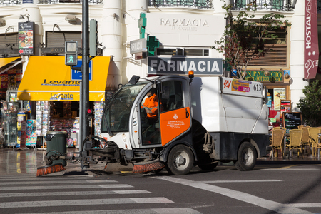 VALENCIA, SPAIN - NOVEMBER 16, 2014: A mechanical street sweeper in downtown Valencia.  The very first street sweeping machine was patented in 1849 by its inventor, C.S. Bishop. 報道画像