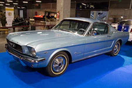 VALENCIA, SPAIN - OCTOBER 17, 2014: A blue classic Ford Mustang at the Retro Auto and Moto Valencia Classic Car Show. The Ford Mustang was introduced to the public on April 17, 1964 at the New York World's Fair. Sajtókép