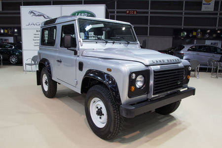 4 wheel: VALENCIA, SPAIN - DECEMBER 4, 2014:  A silver 2013 Land Rover Defener at the Valencia Automovil 2014 Car Show. Production of the Defender model began in 1983. Editorial
