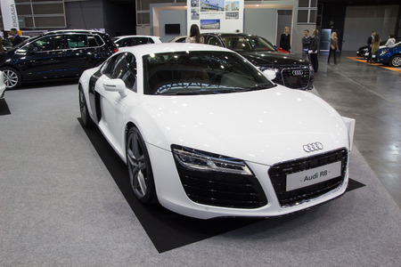 ag: VALENCIA, SPAIN - DECEMBER 4, 2014: A white 2015 Audi R8 sports car at the Valencia Automovil 2014 Car Show. The Audi R8 was introduced by the German automaker Audi AG in 2006.