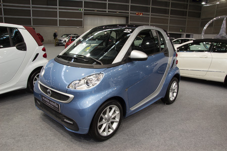 gasoline powered: VALENCIA, SPAIN - DECEMBER 4, 2014: A blue 2014 Mercedes Benz Smart Fortwo Car at the Valencia Automovil 2014 Car Show. The Smart Fortwo car comes in two versions, a gasoline engine and a electric engine model. Editorial