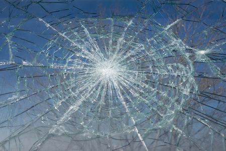 Broken Window with blue sky background.