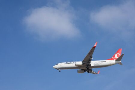 VALENCIA, SPAIN - JANUARY 6, 2015: A Turkish Airlines Boeing 737-800 landing at the Valencia Airport. Turkish Airlines is the national flag carrier airline of Turkey with services to 41 domestic and 206 international airports. Editorial