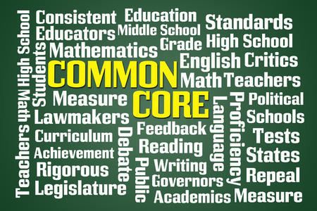 Common Core word cloud on green blackboard background Stock Photo
