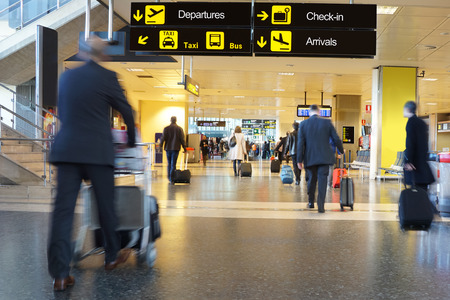 airport luggage: Airline Passengers in an Airport