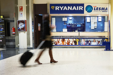 scheduled: VALENCIA, SPAIN - FEBRUARY 14, 2015:  A Ryanair customer service counter at the Valencia airport. In 2014, Ryanair was the largest European airline by scheduled passengers carried.