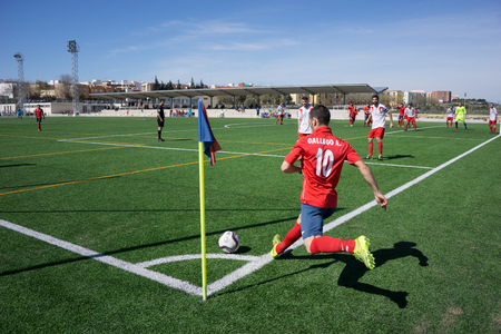 corner kick soccer: VALENCIA, SPAIN - MARCH 29, 2014: An unknown soccer player taking a corner kick during a city league soccer match. Soccer is the most popular sport in Spain. Editorial