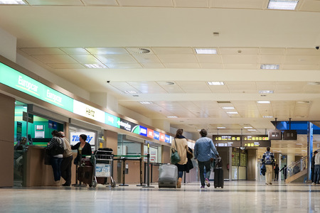 hertz: VALENCIA, SPAIN - NOVEMBER 16, 2014: Airline passengers inside the Valencia Airport. About 4.98 million passengers passed through the airport in 2013.