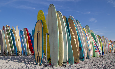 JACKSONVILLE BEACH, FL. USA - JUNE 6, 2015: Surfboards are staged for the Ocean Paddle part of the Never Quit Trident event which involves a 5k Run, 500M Ocean Swim and 1.5k Ocean Paddle. Editorial
