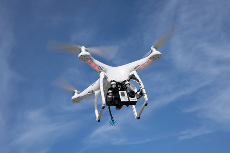 JACKSONVILLE, FL. USA - JUNE 14, 2015: A DJI Phantom consumer drone flying in the sky with a GoPro Hero 3 action camera. The global market for consumer drones is forecast to top $300 million by 2018. Editoriali