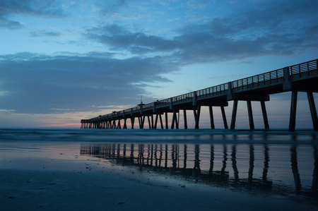 Jacksonville Beach Pier in early morning. Stock Photo