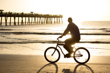 Bike riding in early morning on the beach.