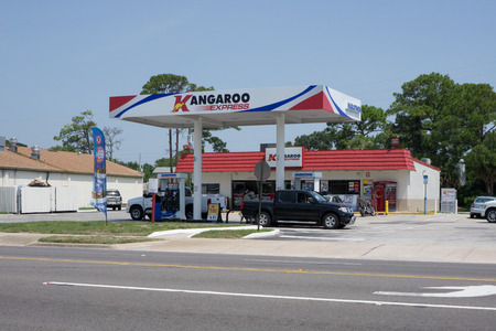 convenience store: JACKSONVILLE, FL-JULY 12, 2015: A Kangaroo Express store gas station in Jacksonville. The Pantry Inc company operates the Kangaroo Express stores with 1,537 stores in thirteen states.