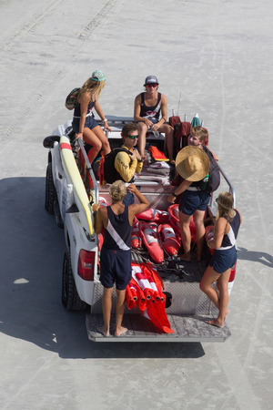 transported: JACKSONVILLE BEACH, FLORIDA, USA - JULY 26, 2015: A group of Jacksonville Beach Lifeguards begining their day by being transported to their stations along 4.1 miles of coastline along Jacksonville Beach.
