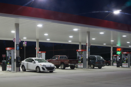 gas station: JACKSONVILLE, FLORIDA, USA - AUGUST 3, 2015: A Gate Petroleum gas station at night. Gate Petroleum is headquartered in Jacksonville and has over 225 gas stations in six states with over 2,200 employees.