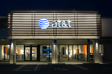 company merger: JACKSONVILLE, FLORIDA, USA - AUGUST 1, 2015: An AT&T Mobility store at night. AT&T Mobility is the second largest wireless telecommunications provider in the United States and Puerto Rico.