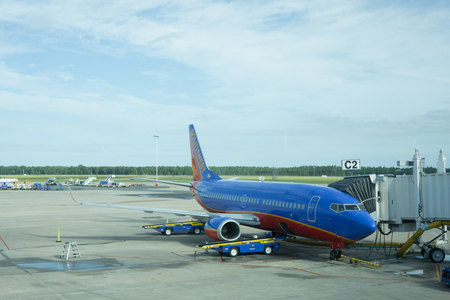 JACKSONVILLE, FLORIDA - AUGUST 30, 2015: A Southwest Airlines airplane parked at the Jacksonville International Airport terminal. Southwest Airlines has nearly 46,000 employees and operates more than 3,400 flights per day.