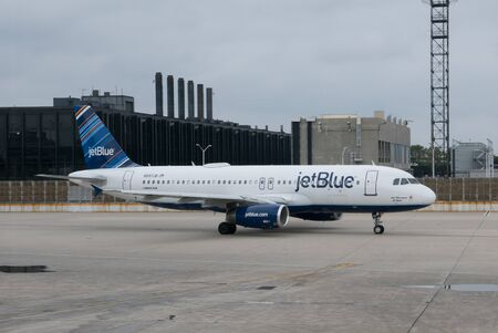 jetblue: CHICAGO, ILLINOIS  USA - AUGUST 30, 2015: A JetBlue Airbus A320 at the OHare Airport. JetBlue Airlines is an American low-cost carrier serving 91 destinations in the U.S., the Caribbean, South America, and Latin America.