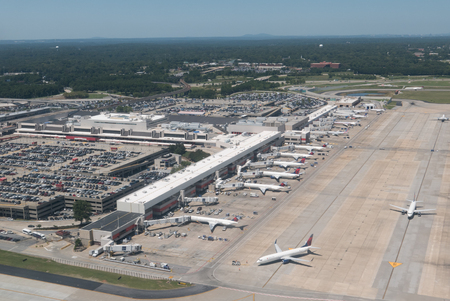 aerial: AtLANTA, GEORGIA-AUGUST 25, 2015: Aerial view of Hartsfield-Jackson Atlanta International Airport. Serving 89 million passengers a year, it is the worlds busiest airport.