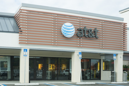 fcc: JACKSONVILLE, FLORIDA, USA - AUGUST 02, 2015: An AT&T Mobility sign in Jacksonville. AT&T Mobility is the second largest wireless telecommunications provider in the United States and Puerto Rico.