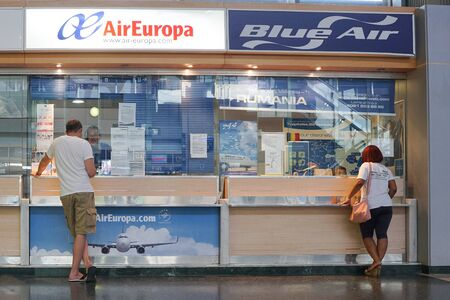 VALENCIA, SPAIN - SEPTEMBER 12, 2015:  An Air Europa and Blue Air ticket counter in the Valencia Airport. Air Europa is the 3rd largest airline in Spain, while Blue Air is a Romanian low-cost airline.
