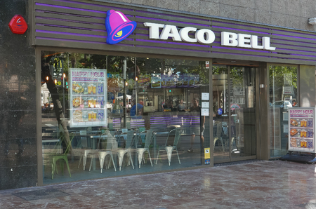 bell: VALENCIA, SPAIN - SEPTEMBER 20, 2015: A Taco Bell fast-food restaurant in downtown Valencia. Taco Bell serves more than 2 billion customers each year in more than 5,800 restaurants. Editorial
