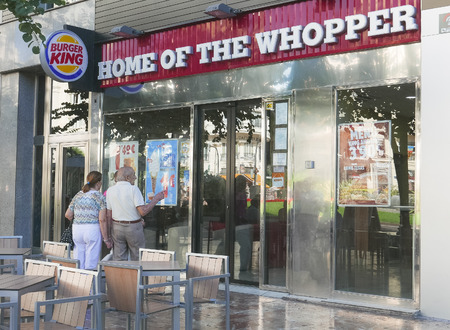 famous industries: VALENCIA, SPAIN - SEPTEMBER 20, 2015:  A Burger King hamburger restaurant in Valencia. Burger King is the world second largest fast food hamburger chain.