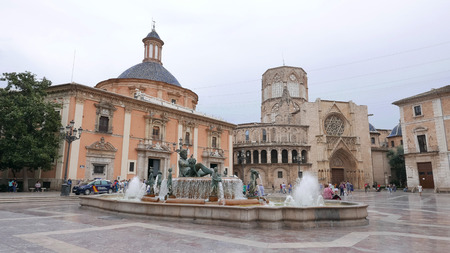 VALENCIA, SPAIN - OCTOBER 3, 2015: Tourist visiting the Plaza de la Virgen in Valenicia. Valencia is the capital of the autonomous community of Valencia and the third largest city in Spain.