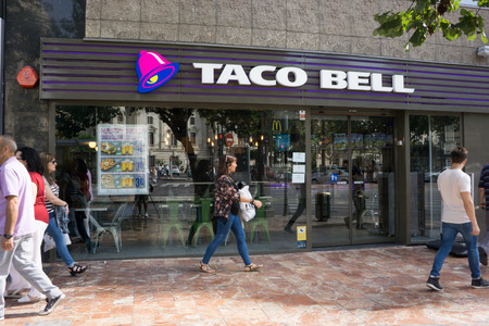 brands: VALENCIA, SPAIN - SEPTEMBER 26, 2015: A Taco Bell fast-food restaurant in downtown Valencia. Taco Bell serves more than 2 billion customers each year in more than 5,800 restaurants. Editorial