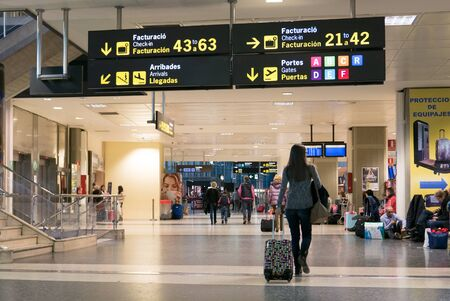 VALENCIA, SPAIN - NOVEMBER 28, 2015: Airline Passengers inside the Valencia Airport. About 4.98 million passengers passed through the Valencia, Spain airport in 2014.